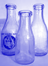 empty milk bottles