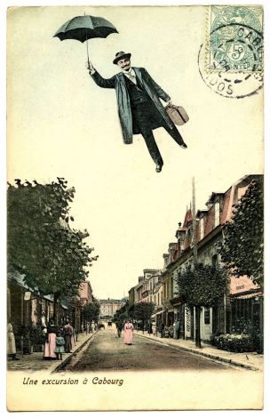 Flying man w umbrella