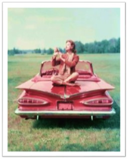 Vintage pink Cadillac woman sitting