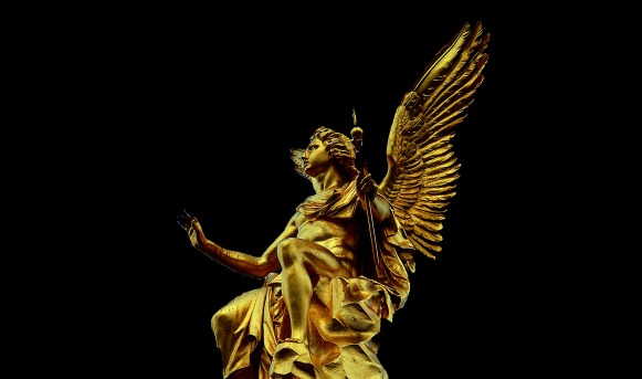 gold angel on black pixabay