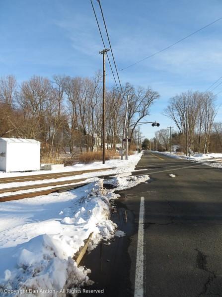 Snowy Railroad tracks Crossing Road Dan Antion