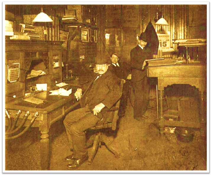 Office speaking tubes hanging on desk, circa 1903 Wikipedia